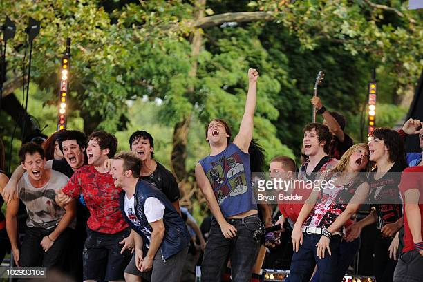 """Cast members of """"American Idiot"""" perform on ABC's """"Good Morning America"""" at Rumsey Playfield on July 16, 2010 in New York City."""