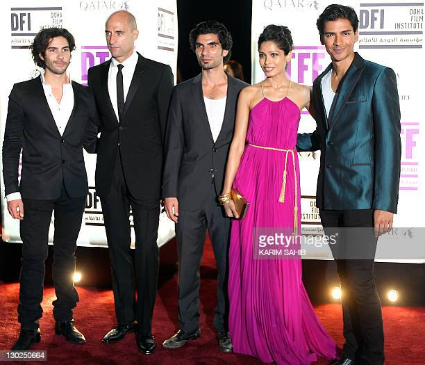 Cast members of Black Gold Tahar Rahim Mark Strong Akin Gazi Freida Pinto and Jan Uddin arrive to the opening of the Doha Tribeca Film Festival in...