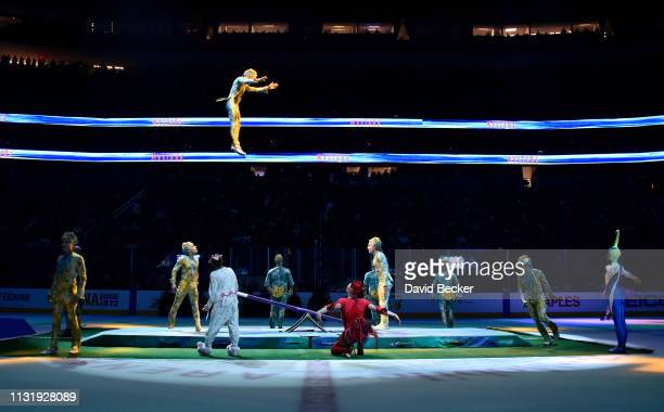 Cast members of Cirque du Soleil's Mystere perform during intermission at TMobile Arena on March 21 2019 in Las Vegas Nevada