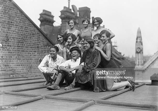 Cast members of Lew Leslie's musical revue 'Blackbirds Of 1926' on the roof of the London Pavilion 1926 Front row Florence Mills Johnny Hudgins and...