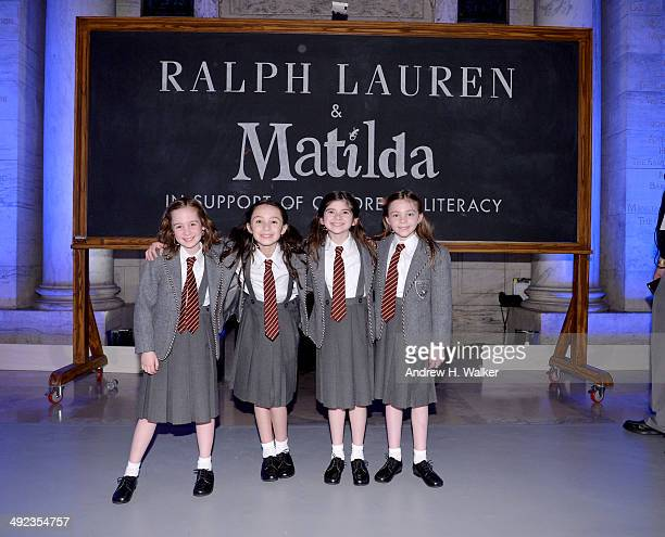 Cast members of Matilda pose at the Ralph Lauren Fall 14 Children's Fashion Show in Support of Literacy at New York Public Library on May 19 2014 in...