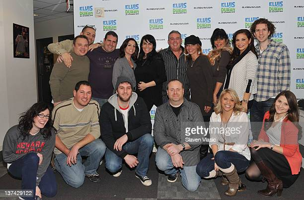 Cast members of reality TV series Mob Wives Renee Graziano Drita D'Avanzo and Angela Big Ang Raiola host Elvis Duran and the crew members pose for...