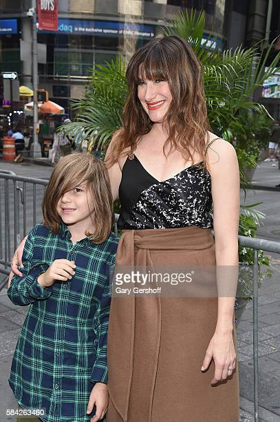Cast members of the film 'Bad Moms' Kathryn Hahn and son Leonard Sandler pose for a picture after ringing the closing bell at NASDAQ at NASDAQ on...