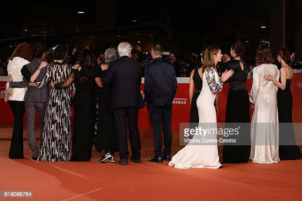 Cast members of the movie walk a red carpet for '7 Minuti' during the 11th Rome Film Festival at Auditorium Parco Della Musica on October 21, 2016 in...