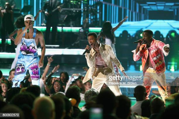 Cast members of 'The New Edition Story' perform onstage at 2017 BET Awards at Microsoft Theater on June 25 2017 in Los Angeles California
