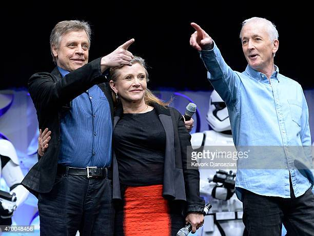 Cast members of the original Star Wars film Mark Hamill Carrie Fisher and Anthony Daniels appear on stage during the kickoff event of Disney's Star...