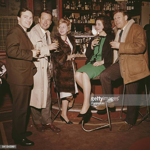 Cast members of the television soap opera Emergency Ward 10 pictured together enjoying a drink in a bar during filming in 1962 Actors pictured...