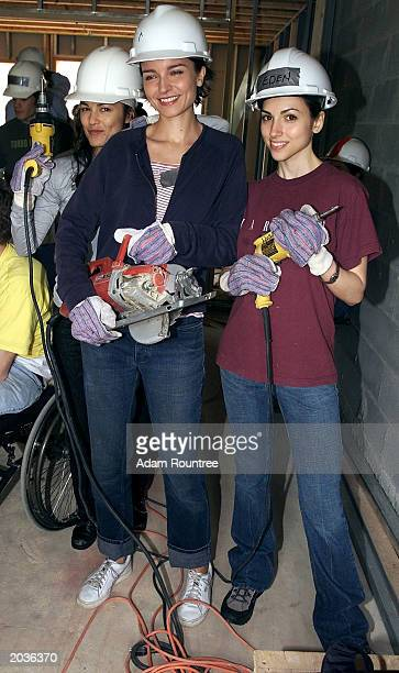 Cast members of TV drama All My Children Eva La Rue Elizabeth Hendrikson and Eden Riegel volunteer to build a Habitat for Humanity house May 28 2003...
