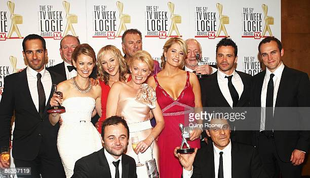 Cast members of Underbelly pose with the award for Most Outstanding Drama Series Miniseries or Telemovie during the 51st TV Week Logie Awards at the...