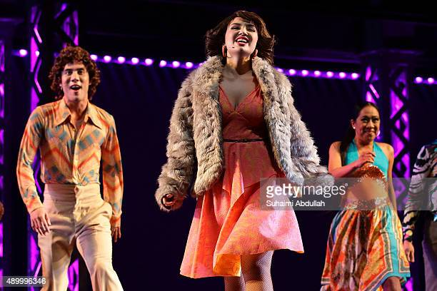 Cast members perform on stage during the opening of Saturday Night Fever The Musical at the Mastercard Theatre Marina Bay Sands on September 25 2015...