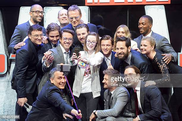 Cast members pose with Lottie French for a selfie during the European film premiere of Captain America Civil War at Vue Westfield on April 26 2016 in...