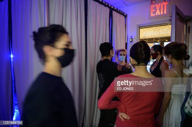 Cast members prepare to stage a free performance of Romeo and Juliet in a vacant shop window on a west side street in Manhattan, New York, on March...