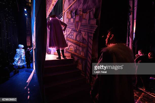Cast members prepare to walk onstage for one of the final scenes of the traditional pantomime Sleeping Beauty at the Hackney Empire on December 13...