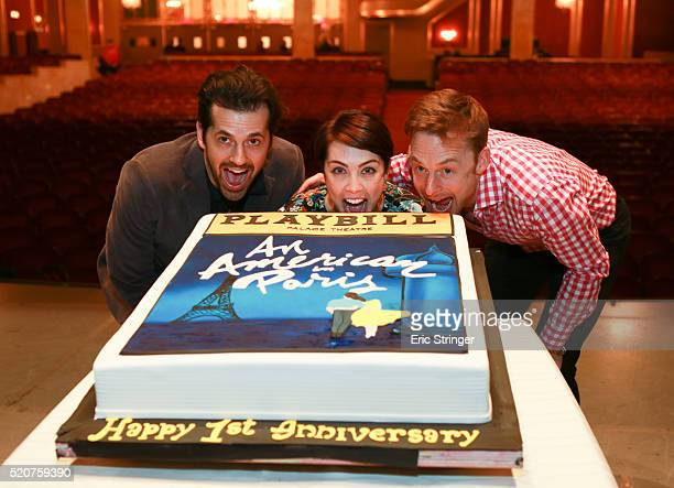 Cast members Robert Fairchild LeAnne Cope and Christopher Wheeldon celebrate the 1 year anniversary of An American in Paris on Broadway with a cake...