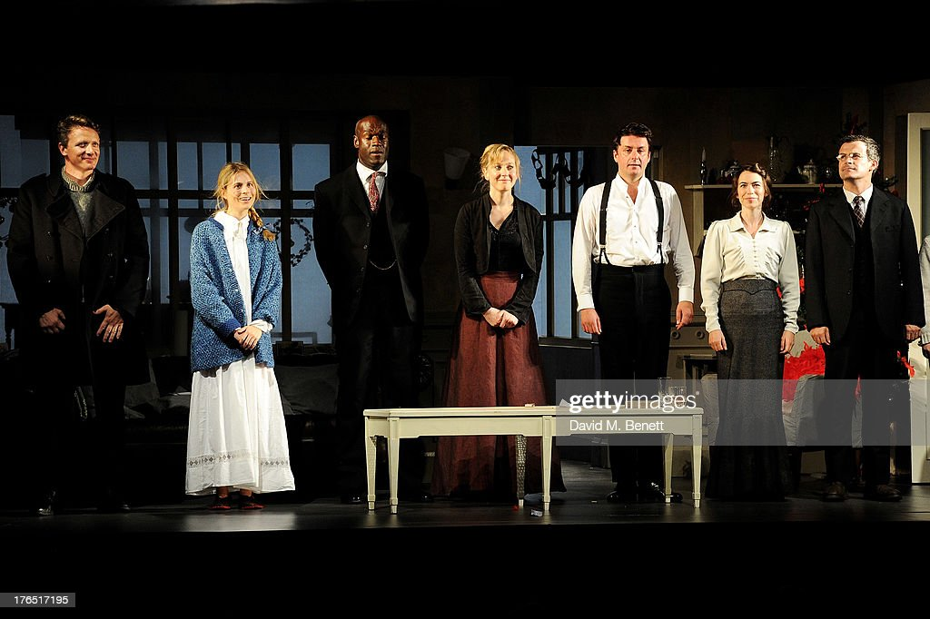 Cast members Simon Desborough, Yolanda Kettle, Steve Toussaint, Hattie Morahan, Dominic Rowan, Caroline Martin and Nick Fletcher bow at the curtain call during the press night performance of 'A Doll's House' at the Duke Of Yorks Theatre on August 14, 2013 in London, England.