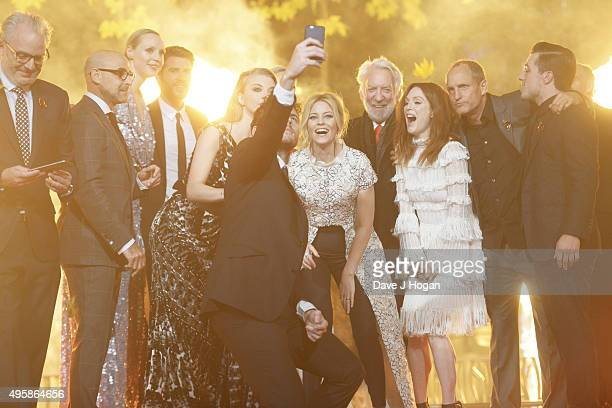 Cast members take a selfie during The Hunger Games Mockingjay Part 2 UK Premiere at Odeon Leicester Square on November 5 2015 in London England
