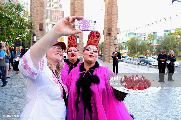 Cast members take a selfie with a fan during a special outdoor performance of Zumanity The Sensual Side of Cirque du Soleil at the New YorkNew York...
