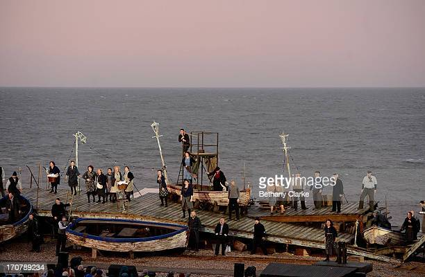 Cast members take to the stage during the first performance of 'Grimes on the Beach' a production of Benjamin Britten's opera Peter Grimes at the...