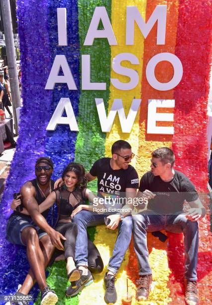 Cast members Toby Onwumere Tina Desai Miguel Angel Silvestre and Brian Smith pose for portrait on top of Sense8 float at LA Pride Music Festival and...