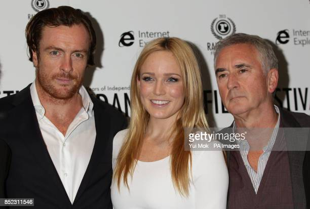 Cast members Toby Stephens, Caity Lotz and Denis Lawson arriving for the UK premiere of The Machine, as part of the 21st Raindance Film Festival, at...