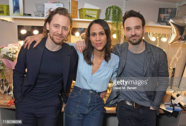 Cast members Tom Hiddleston Zawe Ashton and Charlie Cox pose backstage following the press night performance of Betrayal at The Harold Pinter Theatre...