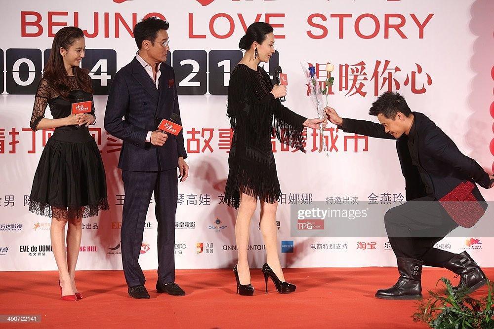 Cast members Tong Liya(L-R),Tony Leung,Carina Lau and director Chen Sicheng attend press conference of Beijing Love Story on Tuesday November 19,2013 in Hong Kong,China.