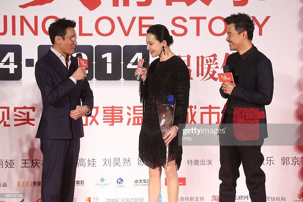 Cast members Tony Leung(L-R) and Carina Lau and director Chen Sicheng attend press conference of Beijing Love Story on Tuesday November 19,2013 in Hong Kong,China.