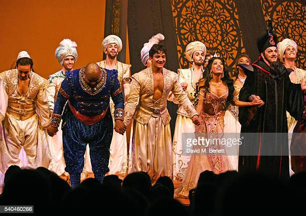 Cast members Trevor Dion Nicholas Dean JohnWilson Jade Ewen and Don Gallagher bow at the curtain call during the press night performance of Disney's...