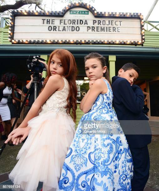 Cast members Valeria Cotto Brooklynn Prince and Christopher Rivera pose during THE FLORIDA PROJECT Cast Crew Orlando Premiere at The Enzian Theater...