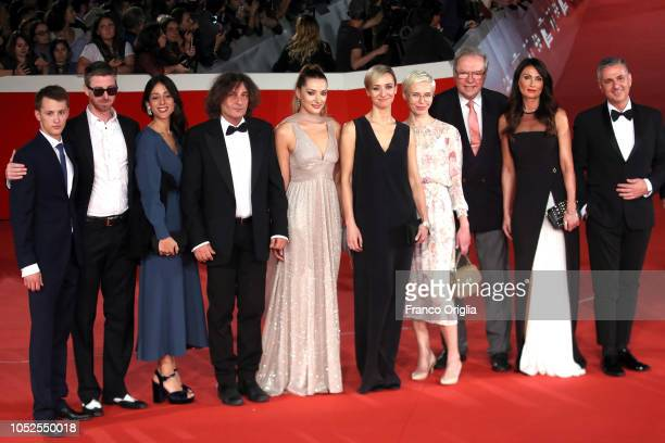 Cast members walk the red carpet ahead of the 'Ether ' screening during the 13th Rome Film Fest at Auditorium Parco Della Musica on October 19 2018...