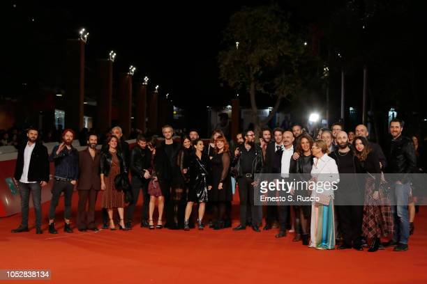 Cast members walk the red carpet ahead of the Noi Siamo Afterhours screening during the 13th Rome Film Fest at Auditorium Parco Della Musica on...