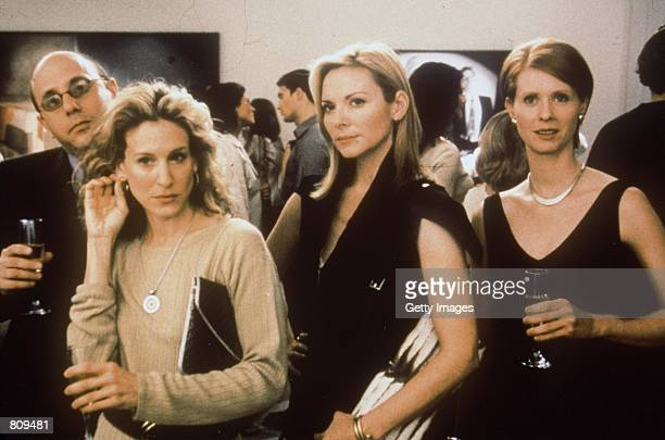 Cast members Willie Garson Sarah Jessica Parker Kim Cattrall and Cynthia Nixon act in a scene from the HBO television series Sex and the City third...