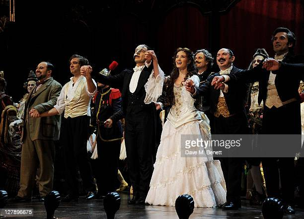 Cast members Wynne Evans Hadley Fraser Ramin Karimloo Sierra Boggess Barry James and Gareth Snook bow on stage during the 25th Anniversary...