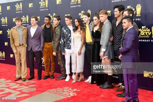 Cast of '13 Reasons Why' attends the 2018 MTV Movie And TV Awards at Barker Hangar on June 16 2018 in Santa Monica California