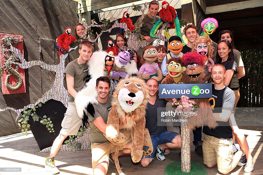 Cast of Avenue Zoo and Rob Morrison, Darren Bluestone, Michael Liscio Jr., and Kate Lippstreu of Avenue Q visit at Bronx Zoo on July 12, 2012 in New York City.