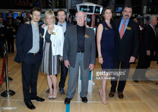 Cast of 'Blue Bloods' Will Estes Amy Carlson Donnie Wahlberg Len Cariou Bridget Moynahan and Tom Selleck visit the New York Stock Exchange on May 16...