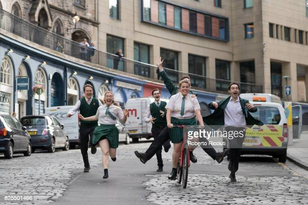 Cast of company Theatre Re run through Victoria Street during a photocall to promote their show 'The Nature of Forgetting' during the Edinburgh...