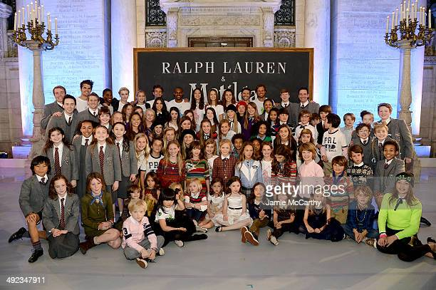 Cast of Matilda poses with models at the Ralph Lauren Fall 14 Children's Fashion Show in Support of Literacy at New York Public Library on May 19...