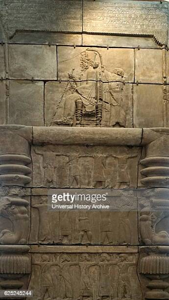 Cast of palace doorway from Persepolis Iran circa 470450 BC Depicts an ancient Persian ruler seated on a throne with sceptre and lotus flower An...