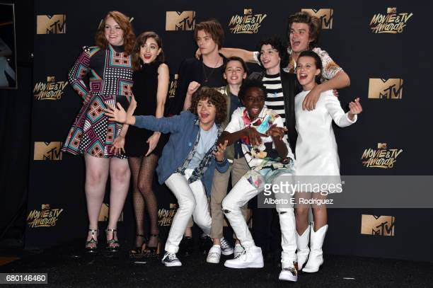Cast of 'Stranger Things', winner of the Show of the Year award, poses in the press room during the 2017 MTV Movie And TV Awards at The Shrine...
