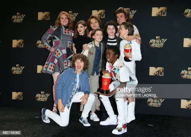 Cast of 'Stranger Things' winner of the Show of the Year pose in the press room during the 2017 MTV Movie TV Awards at the Shrine Auditorium in Los...
