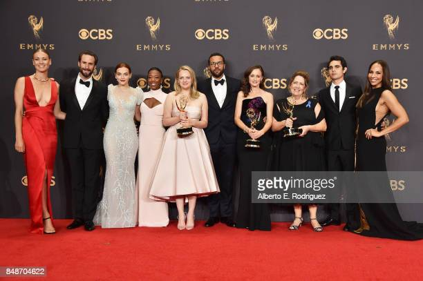 Cast of 'The Handmaid's Tale', winners of Outstanding Drama Series, pose in the press room during the 69th Annual Primetime Emmy Awards at Microsoft...
