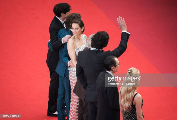 """Cast of the movie """"Annette"""" including Adam Driver and Marion Cotillard attend the """"Annette"""" screening and opening ceremony during the 74th annual..."""