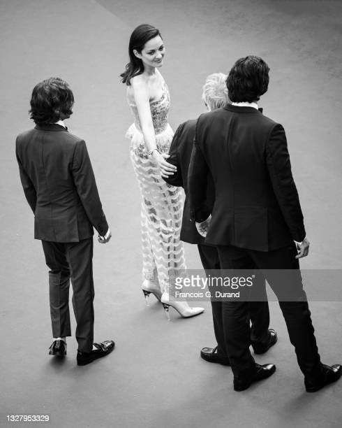 """Cast of the movie """"Annette"""" including Adam Driver, Leos Carax and Marion Cotillard attend the """"Annette"""" screening and opening ceremony during the..."""