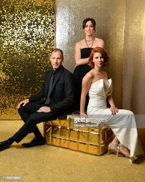 """Cast of """"Working Moms"""" Philip Sternberg, Catherine Reitman and Dani Kind pose inside the 2019 Canadian Screen Awards Portrait Studio held at Sony..."""