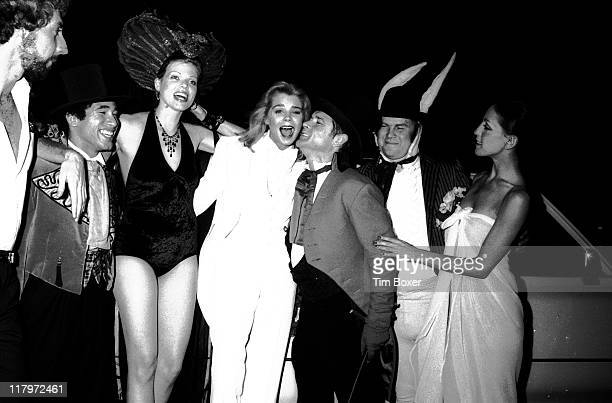 Cast portrait at the premiere of the film 'Alice In Wonderland An XRated Musical Fantasy' outside the Eastside Cinema New York New York August 1976...