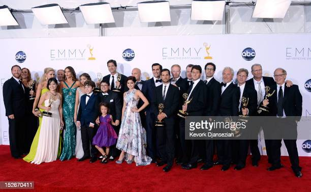 Cast writers and producers of 'Modern Family' pose in the press room during the 64th Annual Primetime Emmy Awards at Nokia Theatre LA Live on...