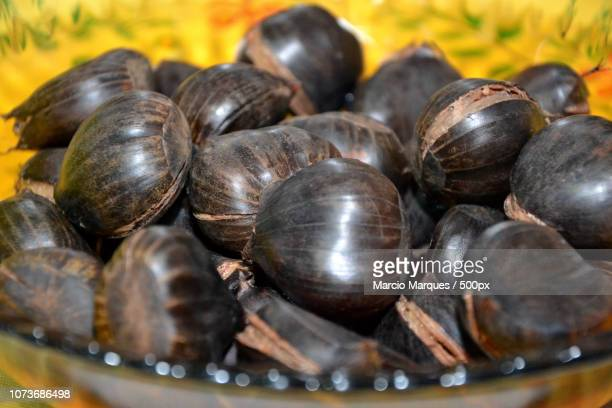 castanhas portuguesas - castanhas stock pictures, royalty-free photos & images