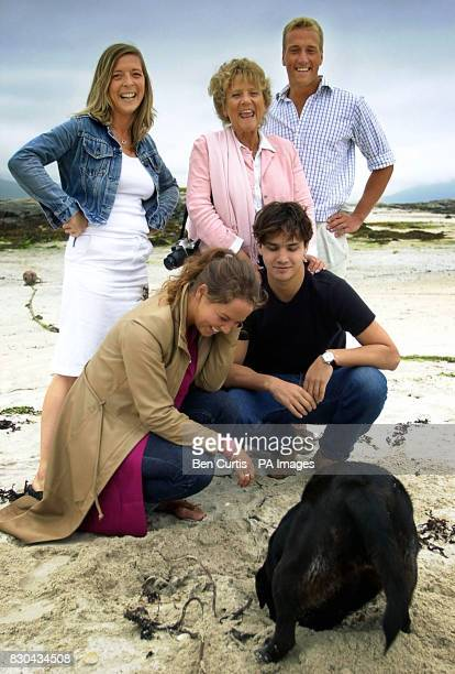 BBC Castaway Ben Fogle with his family play with his dog Inca on the beach as the Castaways have their first family visit in seven months on the...