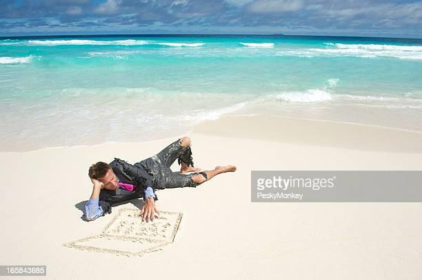 Castaway Businessman Lies on Beach Using Sand Laptop